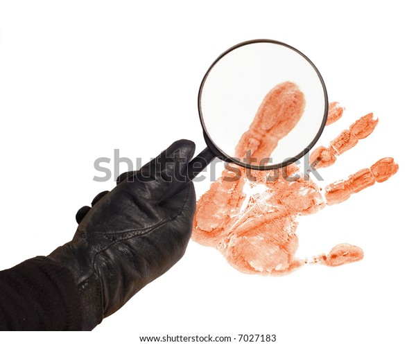 Hand of a detective with magnifier and trace