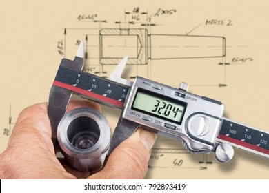 Hand and digital measuring tool. Machinist gauges the diameter of metal workpiece by the caliper and checks it with technical documentation.