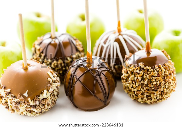 Hand dipped caramel apples decorated for Halloween.