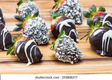 Hand dipped strawberries in chocolates with some rolled in roasted cashews and some with a white chocolate drizzle