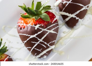 hand dipped strawberries in dark chocolate with a drizzle of white chocolate for a garnish