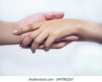 Hand of doctor holding the hand of a patient for the consolation