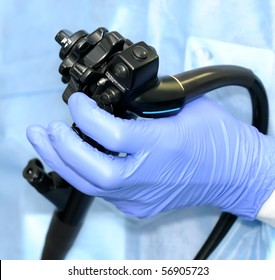 Hand of doctor managing modern endoscope