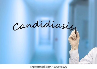 Hand of doctor with marker writing Candidiasis