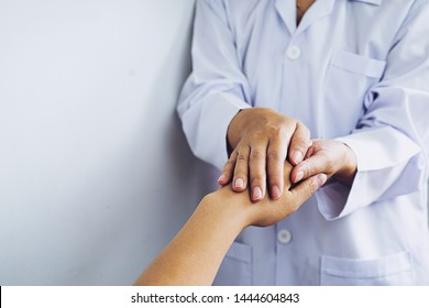 Hand of doctor reassuring her female patient,Partnership, trust and medical ethics concept. Bad news lessening and support. Patient cheering and support,Take care and trust concept,