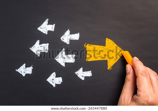 Hand drawing arrow sign in opposite direction from others