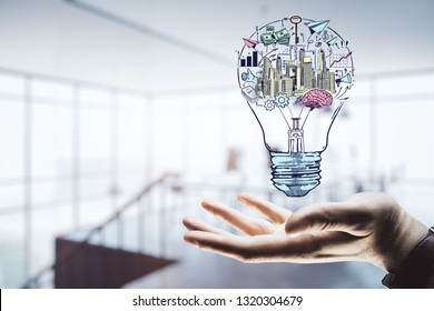 Hand drawing business idea concept on office background.