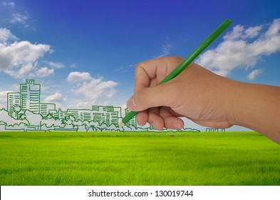 hand drawing city on field - green city concept