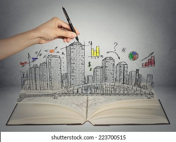 hand drawing city skyline business concept growing out of open book on grey wall background. Real estate development, house market economy, investment opportunity