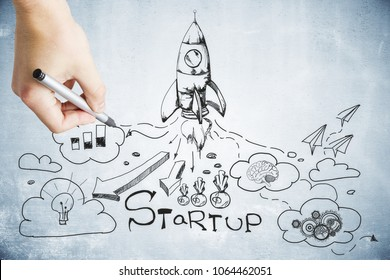 Hand drawing creative startup sketch on creative background. Entrepreneurship and success concept