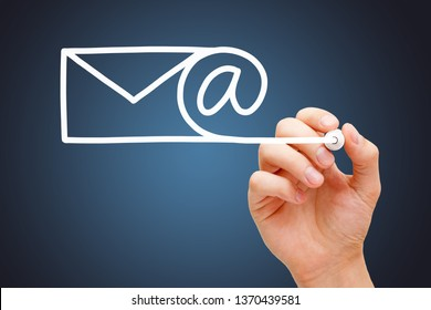 Hand drawing Email, internet communication, or newsletter concept with white marker on transparent wipe board on dark blue background.