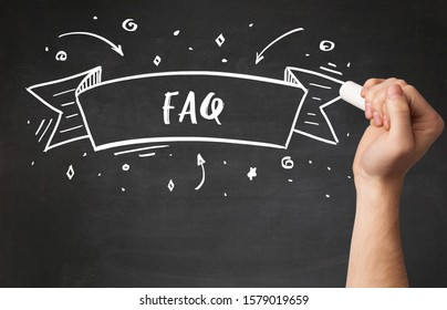 Hand drawing FAQ abbreviation with white chalk on blackboard