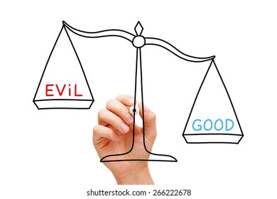 Hand drawing Good or Evil scale concept with marker on transparent wipe board isolated on white.