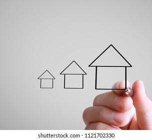 Hand drawing a house