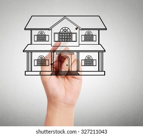 Hand drawing a house model