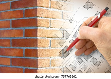 Hand drawing an imaginary cadastral map of territory with buildings, roads and brick wall on foreground