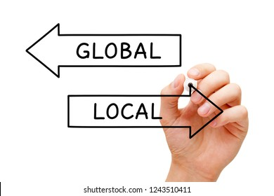 Hand drawing Local or Global arrows concept with marker on transparent wipe board. Think global, act local.