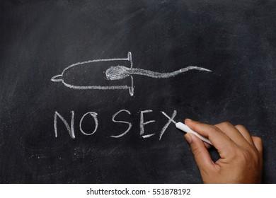 Hand drawing no sex sperm whit condoms on blackboard