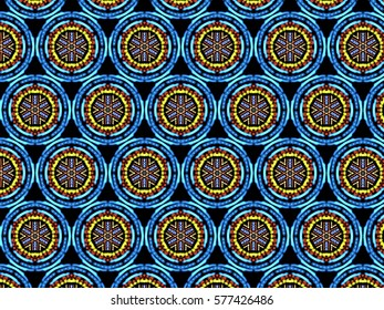 A hand drawing pattern made of blue, yellow and red on a black background.