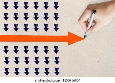 Hand drawing red arrow on concrete wall background. Leadership and success concept