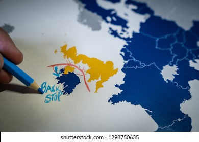 Hand drawing a red line between the UK and Northern Ireland, Backstop and Brexit concept. The Backstop solution for the Irish border is one of the main EU and UK negotiations.