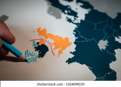 Hand drawing a red line between the UK and Northern Ireland,