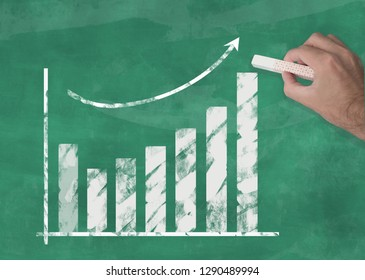 hand drawing rising curve chart on chalkboard illustrating business success or rising stock prices