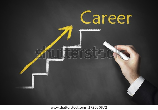hand drawing stairs career on a chalk board