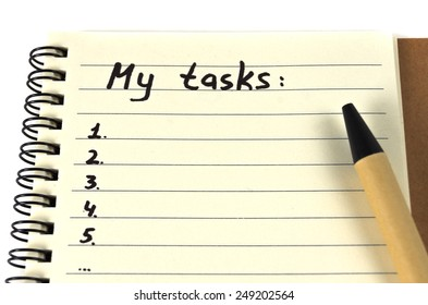 Hand drawing task list on notebook from recycling paper on white background