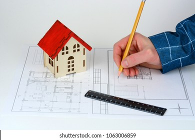 Hand drawing technical plan, sketch, documents. Pencil, ruler and wooden house on blueprints. ?oncept for jurist, notary, legal, juristic legislation, consulting, real estate.