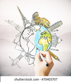 Hand drawing unfinished globe sketch with sights and monuments on light background. Traveling concept