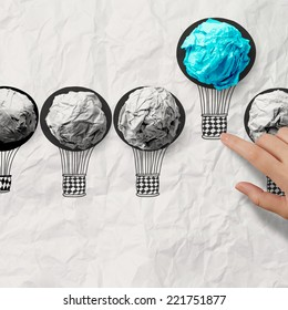 hand drawn air balloons with crumpled paper ball as leadership concept