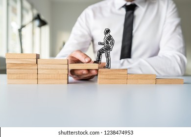 Hand drawn businessman going up the wooden steps with his business mentor supporting one of the steps in a conceptual image of teamwork and support.