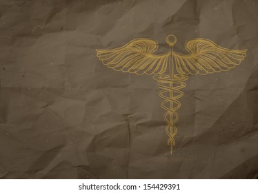 hand drawn Caduceus on wrapping recycle paper background as concept