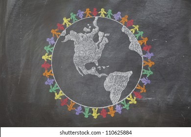 A hand drawn chalkboard shows multi-ratial people holding hands around the world to show care for the earth, peace, and unity