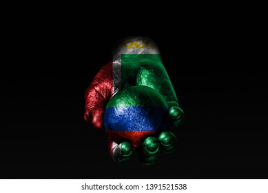 A hand with a drawn Chechnya flag holds a ball with a drawn Dagestan flag, a sign of influence, pressure or conservation and protection. Horizontal frame