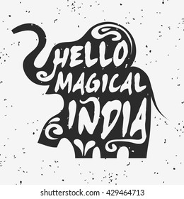 Hand drawn creative typographic poster with elephant. Hello, magical India. Grunge texture. T-shirt design, label, decor elements, greeting and postal cards.
