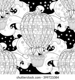 Hand drawn doodle outline  air baloon in flight decorated with floral ornaments.Zentangle illustration.Sketch for tattoo, poster, children or adult coloring pages.Boho style seamless pattern.