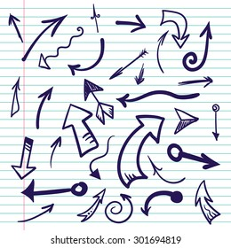 Hand drawn doodle simple arrows on lined paper