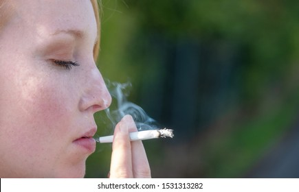 Hand drawn and hand-rolled cigarette of an addicted woman enjoying a cigarette outside with space for your text, copy space