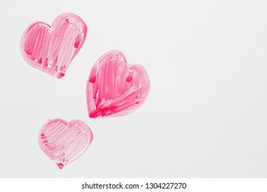 hand drawn pink Valentines Day  hearts on a whiteboard