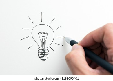 Hand drawn shining light bulb isolated on white background
