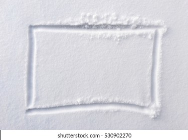 hand drawn square shape in the fresh snow