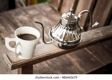 Hand drip coffee , Barista pouring water on coffee