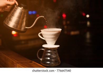 Hand drip coffee, Barista pouring water on coffee ground with filter. Drip coffee, barista pouring water on coffee ground with filter.