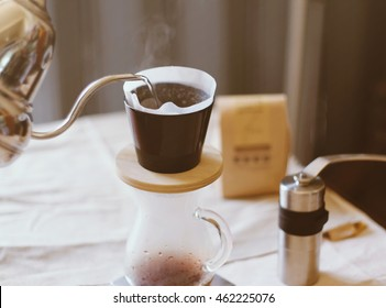 Hand drip coffee, pouring water on coffee ground with filter drip style