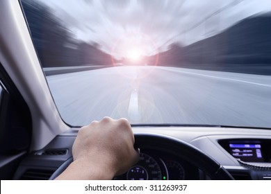 hand driving a car with speed on the street
