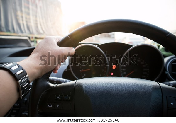 Hand Driving with Traffic Background