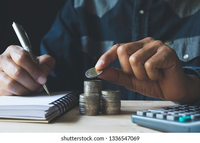 Hand drop a coin with money coin stack growing for business. financial and accounting concept.