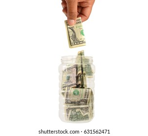 Hand dropping one dollar bill in container filled with money isolated on white background